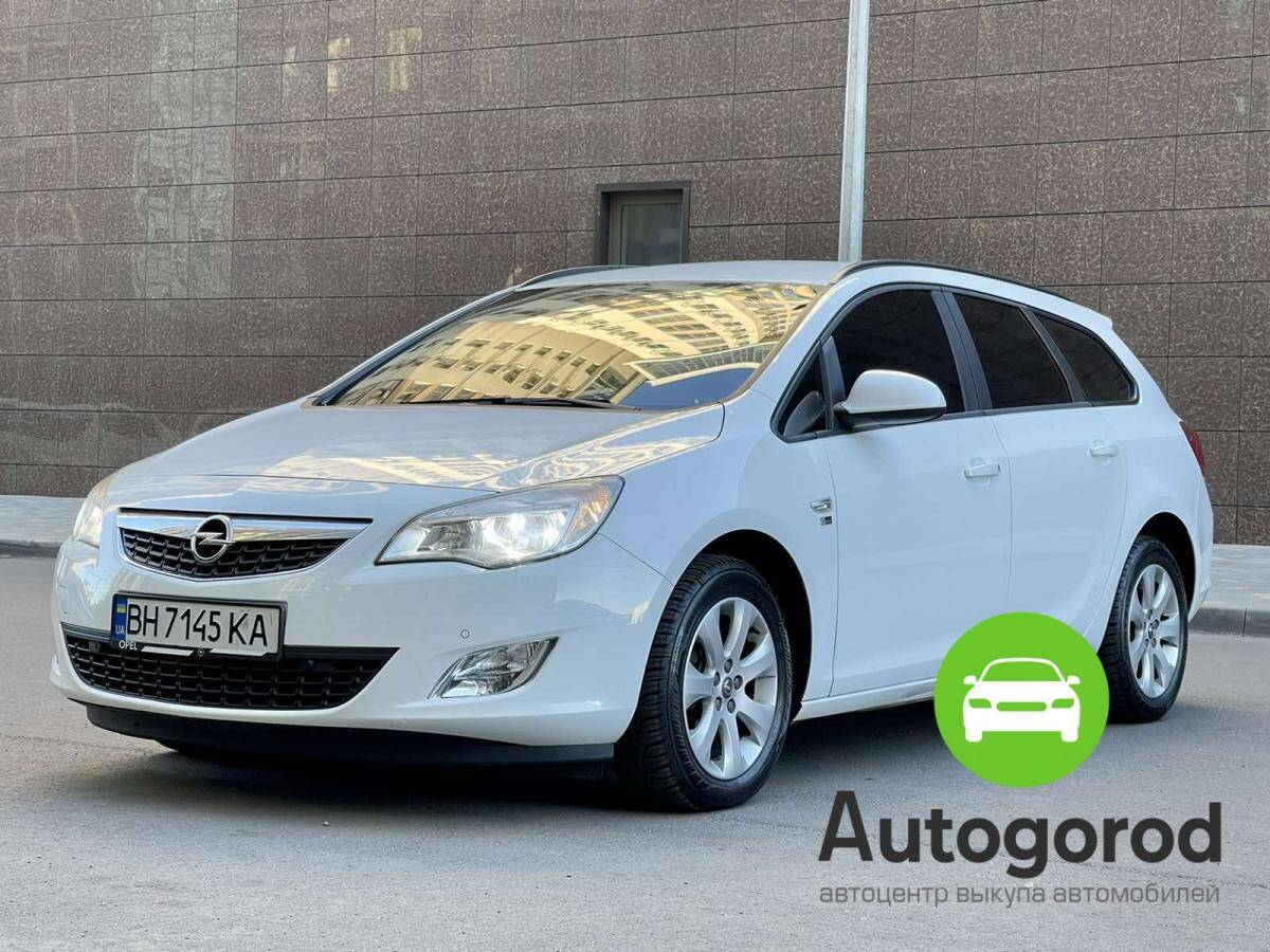 Авто Opel                                         Astra 2012 года фото 4