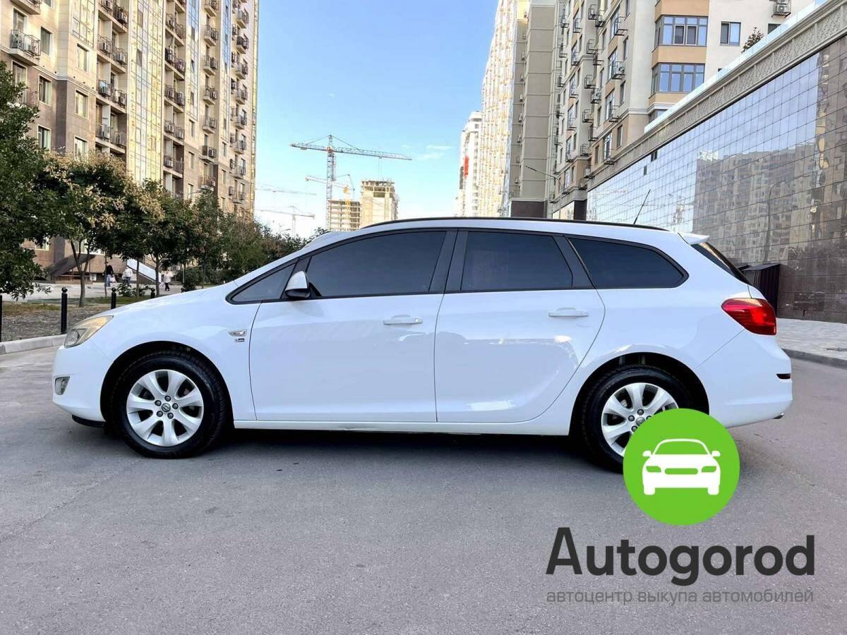 Авто Opel Astra                                         2012 года фото 6